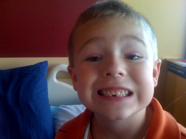 Dane lost his first tooth at the rehab hospital!