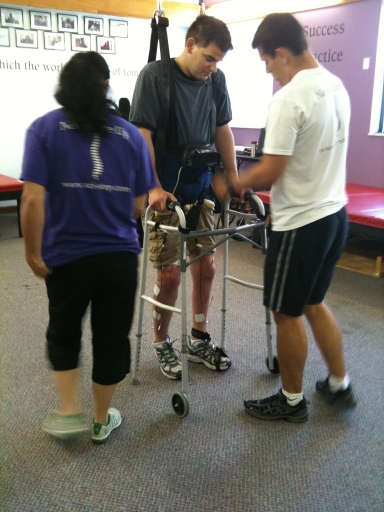 Ryan was put into a harness for safety and so that he didn't have to bear his full body weight.  Electrodes were placed on his legs and attached to the walker.