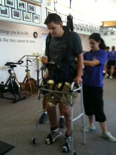 When he pushed the button on the right side of the walker, electrodes on his right leg would stimulate the muscles to step. When he pushed the button on the left side of the walker, the electrodes on his left leg would stimulate those muscles to step.