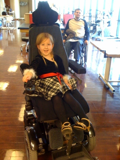 Naomi trying out the electronic wheelchair.